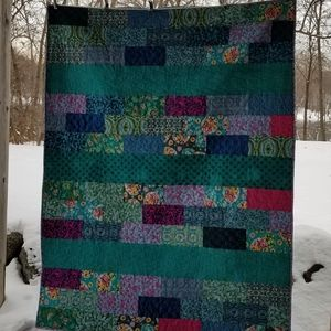 Handmade twin topper quilt in bright colors
